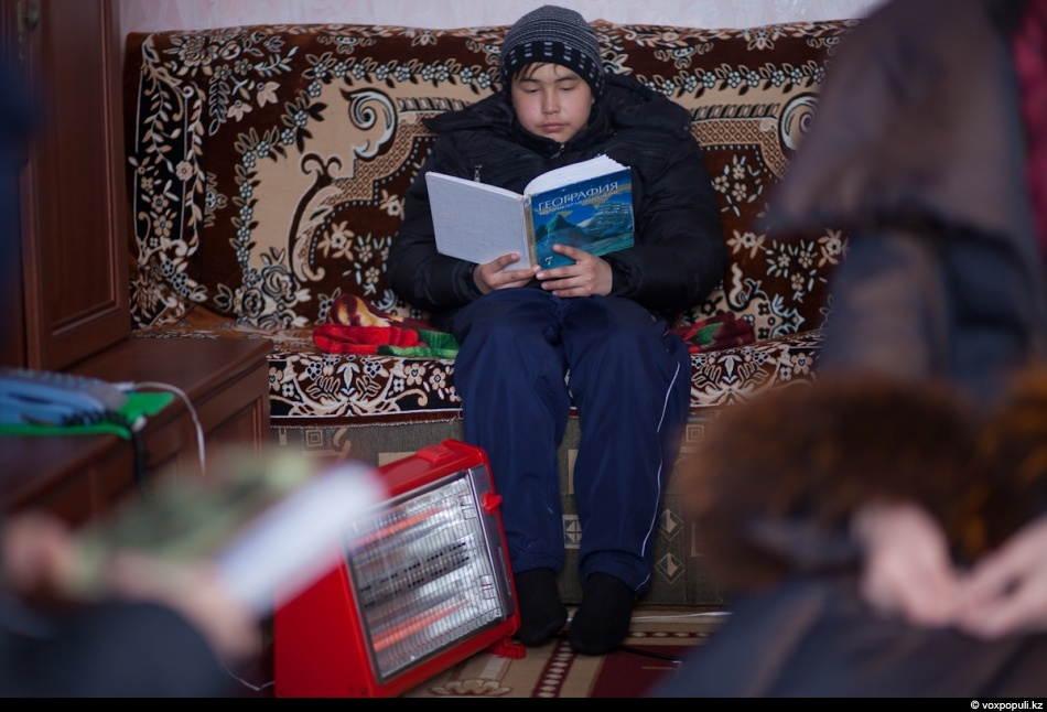 These days Aliya Kaldybayeva's family lives in one room with an electric heater. They eat...